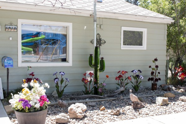 An overall shot of the Weikart's front yard, including gravel, rocks and metal plants.