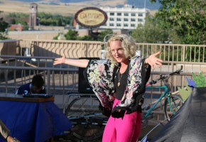 Lelia Johnson of the Agile Rascals does her best grandma impression while welcoming the people of Lewistown to their well-attended showcase last Tuesday on the Lewistown Public Library patio.  Photo by Charlie Denison