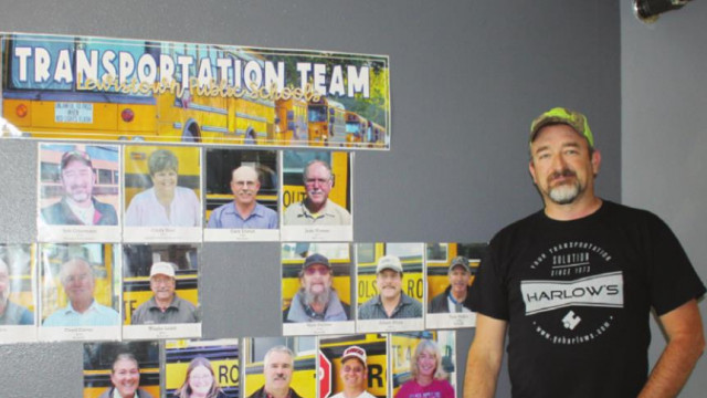 Robert Odermann stands in front of the transportation team members' photos and is eager to fill the empty spaces with new family members. Photo by Miriam Campan